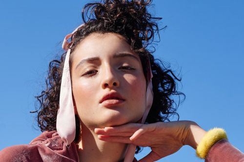 Helena Vie embraced her natural curls and ended up shooting for Vogue Brazil